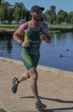 Tim run with TA suit